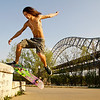 "Matt Brewer, of New Albany, kick-flips onto a grind box while skateboarding at the skate park on the New Albany Riverfront on Thursday evening. ""I'm not getting any younger,"" Brewer said. At 26, he has been skateboarding for 12 years and tries to make it to the skate park as often as possible. Staff photo by Christopher Fryer"