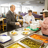 New Albany mayor Jeff Gahan is served a plate for lunch during a visit to the Riverview Towers for Nutrition Awareness Day on Wednesday in downtown New Albany. The day is designed to increase awareness of the importance of proper nutrition habits. March is the American Dietetic Association's National Nutrition Month. Staff photo by Christopher Fryer