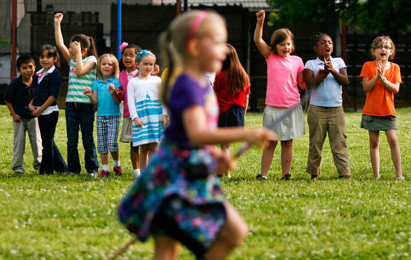 First graders cheer on kindergarten students while they compete in their stick horse Kentucky Derby at Fairmont Elementary School in New Albany on Thursday morning. Staff photo by Christopher Fryer