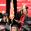 Graduate Safiyyah Rasool waves to her family before commencement ceremonies Monday afternoon at Indiana University Southeast. Staff photo by C.E. Branham
