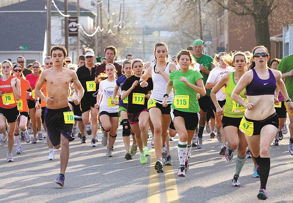 Runners head east on Chestnut Street at the beginning of The Shamrock on Tuesday.  Staff photo by C.E. Branham
