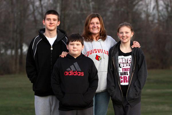 Carol Compton with her children Michael, Matthew and Robin. Staff photo by C.E. Branham
