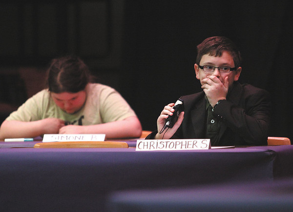 Seventh-grader Christopher Sons listens to his question in the final competition round of the annual National Geographic Bee at River Valley Middle School.  Staff photo by C.E. Branham