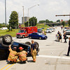 Emergency crews work the scene of an injury accident involving a Jeep Liberty SUV with three occupants and a Mazda sedan with two occupants at the intersection of West Fifth and West Spring streets in New Albany on Friday afternoon. The wreck occurred at about 1:15 p.m. and the driver and passengers in the SUV were taken to Floyd Memorial Hospital. Staff photo by Christopher Fryer