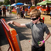Dean Flint, 11, Floyds Knobs, plays kerplunk at the St. Mary's of the Knobs School booth during the annual Mount St. Francis Picnic in Floyds Knobs on Saturday afternoon. Staff photo by Christopher Fryer
