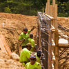 Laborers with AML Inc. work on a retaining wall between the future sites of two softball fields at Vissing Park in Jeffersonville on Thursday afternoon. Staff photo by Christopher Fryer