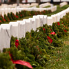 Wreaths rest against head stones after a wreath laying ceremony at the New Albany National Cemetery on Saturday afternoon. Members of the Indiana Wing Civil Air Patrol's Falcon Composite Squadron held a ceremony and placed more than 750 wreaths around the cemetery to honor veterans for the holiday season as part of Wreaths Across America. Staff photo by Christopher Fryer