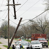A utility worker looks over the damage after an accident at the intersection of Greenvalley Road and Gordan Drive in New Albany on Friday afternoon. No one was injured in the accident. Staff photo by Christopher Fryer