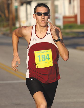 Aaron Beck of Sellersburg won the men's race in The Shamrock. Staff photo by C.E. Branham