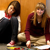 Kaitlyn Martin and Courtney Cummings, sophomores, pass the time in a study hall in Jolie Lindley's classroom on Feb. 20 at Henryville Junior/Senior High School. A year after the school was destroyed by a tornado, the morale of students, teachers, staff and administrators has improved. Staff photo by Jerod Clapp
