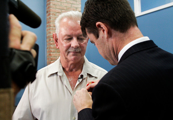 Congressman Todd Young pins medals on Vietnam War veteran Robert Austin, of Madison, in the U.S. House of Representatives District Office in Jeffersonville on Friday afternoon. Austin served in the U.S. Navy as an airman on the U.S.S. Yorktown from 1964 to 1966, but never received his two Bronze Stars,Vietnam Service Medal or his National Defense Service Medal. Staff photo by Christopher Fryer