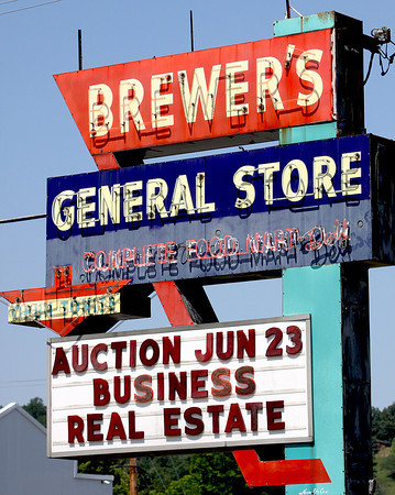 The historic Brewer's General Store neon sign has greeted visitors for decades. Staff photo by C.E. Branham