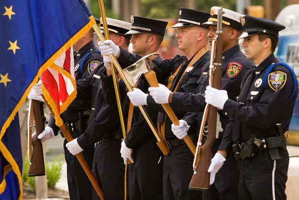 "New Albany firefighters and police officers present the colors before the playing of ""The Star Spangled Banner"" at the official opening of the Bicentennial Park at the corner of Spring and Pearl streets in downtown New Albany on Friday evening. Staff photo by Christopher Fryer"