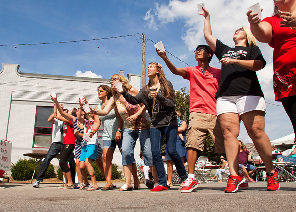 Participants compete in the grape tossing contest during the fourth annual Jeffersonville Italian Festival on Saturday afternoon. Staff photo by Christopher Fryer