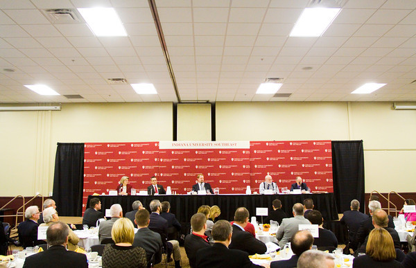 Retired Indiana University economics professor Willard Witte, far right, speaks as part of a panel discussing current economic facts and subjects affecting Southern Indiana and Louisville during an economic outlook breakfast in the Hoosier Room at IU Southeast on Friday morning. Staff photo by Christopher Fryer