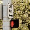 A one-way traffic sign sits at the intersection of Scribner Drive and Spring Street in downtown New Albany on Friday afternoon. Staff photo by Christopher Fryer