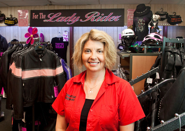 Sharon Fink, owner of Fink's, stands in the women's section of her business in New Albany. She keeps a regular inventory of women's gear, apparel and accessories due to the growing number of female motorcyclists. Staff photo by Christopher Fryer