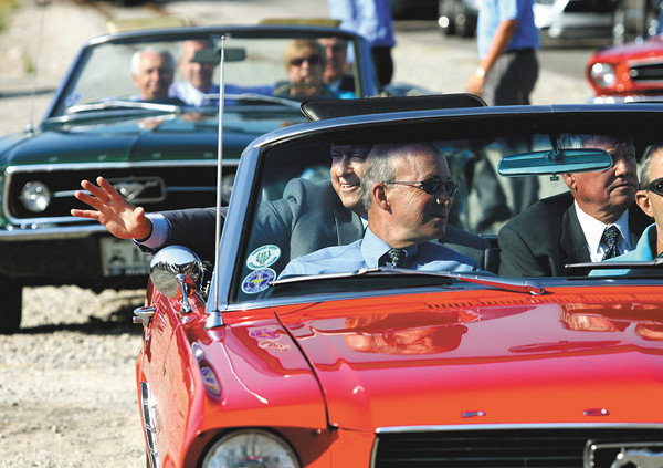 Indiana Gov. Mitch Daniels, Jeffersonville Mayor Mike Moore and Utica Town board President Hank Dorman arrive at the East End Bridge Crossing groundbreaking ceremony in a 1960's Ford Mustang. The cars represented the era in which the East End Bridge was added to the region;s long range transportation plans. Staff photo by C.E. Branham