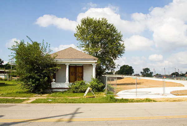 A house sits on its location along Pearl Street in Jeffersonville on Thursday morning. It is one of four houses that are scheduled to be relocated to a vacant lot at the corner of Pearl and West Maple streets. Staff photo by Christopher Fryer