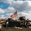 An American flag flies over what is left of Mike and Freda Montgomery's garage in Henryville Sunday afternoon. Staff photo by Christopher Fryer