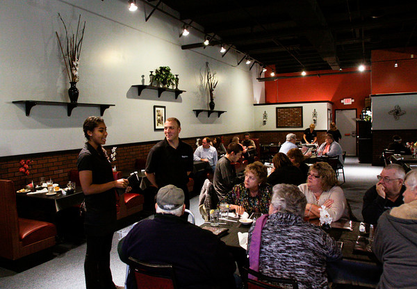 Servers work the dining room during dinner at Magdalena's restaurant in the Copperfield Commons shopping center in Georgetown on Tuesday evening. Staff photo by Christopher Fryer