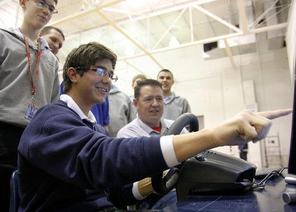 Pierce Crawley, senior, tries his skills with the texting and driving simulator at Our Lady of Providence's Students Against Destructive Decisions event on Wednesday. Geoff Grow, state director for SADD, helped direct students through the simulator, which had only been used in the state once before. Staff photo by Jerod Clapp