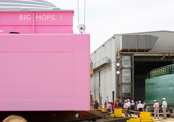 Spectators and crew gather to launch Big Hope 1, a pink barge built by Jeffboat for Ceres Barge Lines. Staff photo by C.E. Branham