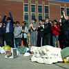 Fifth-graders at Highland Hills Middle School cheer after all of their egg protectors were dropped from the top of the school. Students researched and developed their devices, keeping track of any modifications they made. Staff photo by Jerod Clapp