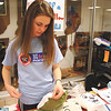 Brianna Patterson, a Floyd Central High School student and member of the National Honor Society, sews a pillow at the Floyd Central Dance Marathon on Saturday that benefited Riley Hospital. The dance marathons were started in 1991 as a tribute to Ryan White, the Indiana teenager who passed away from after contracting AIDS in 1990. The marathons have been a huge success for Riley, as the combination of events usually raise $2 million each year.  Photo by Amanda Arnold