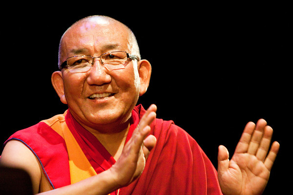Arjia Rinpoche speaks with Rajiv Mehrotra during the Festival of Faiths at Actors Theatre of Louisville on Thursday afternoon. Rinpoche is the director of the Tibetan Mongolian Buddhist Cultural Center in Bloomington. Staff photo by Christopher Fryer