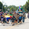 Cub Scout Pack 41 make their way down South Ferguson Street during the Henryville Community Day Parade on Saturday morning. Staff photo by Christopher Fryer