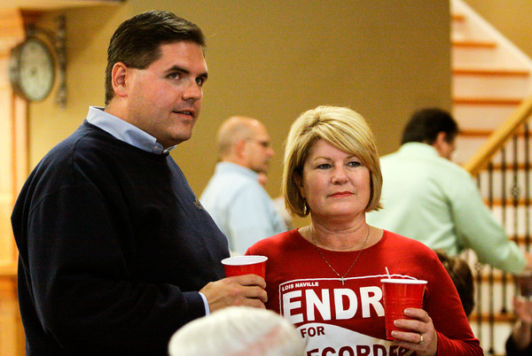 Floyd County Recorder Republican candidate Lois Endris talks with Indiana House District 72 incumbent Ed Clere as they watch results come in at the Calumet Club in New Albany on Tuesday evening. Staff photo by Christopher Fryer