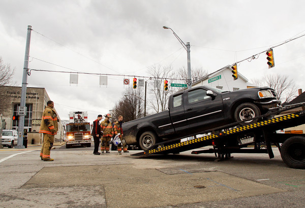 Emergency crews work the scene of a two-vehicle accident at the intersection of Scribner Drive and Spring Street in New Albany on Wednesday afternoon. The accident happened at about 2:30 p.m. and no injuries were reported. Staff photo by Christopher Fryer