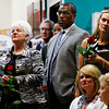 Audience members listen to speakers as they address issues concerning child abuse during a press conference to kick off the Partnership to Eliminate Child Abuse awareness campaign in the lobby of Kosair Children's Hospital in Louisville on Wednesday morning. Staff photo by Christopher Fryer
