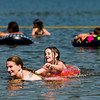Jena Allaben, left, and her daughter Destiny Wooten, 5, both of Clarksville, horse around in the swimming area at Deam Lake State Recreation Area near Borden on Friday afternoon. A heat wave continues to affect the area with high temperatures forecast to reach the 100s again today. Staff photo by Christopher Fryer