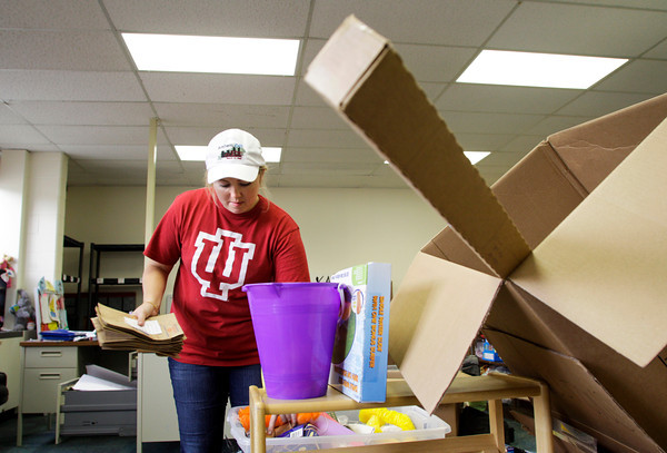 New Directions coordinator Evan Gaubatz, of Jeffersonville, unpacks and organizes supplies in the new Open Door Youth Services offices in the recently opened Pine View Government Center along Corydon Pike in New Albany on Tuesday afternoon. Staff photo by Christopher Fryer