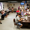 Attendants of the fourth-annual Ice Cream Social eat desserts in the basement of the historic Division Street School in New Albany on Saturday afternoon. The event is put on by the Friends of the Division Street School to celebrate the continuation of their project as well as to get the public into the historic building to help educate them on a part of New Albany's history. Staff photo by Christopher Fryer