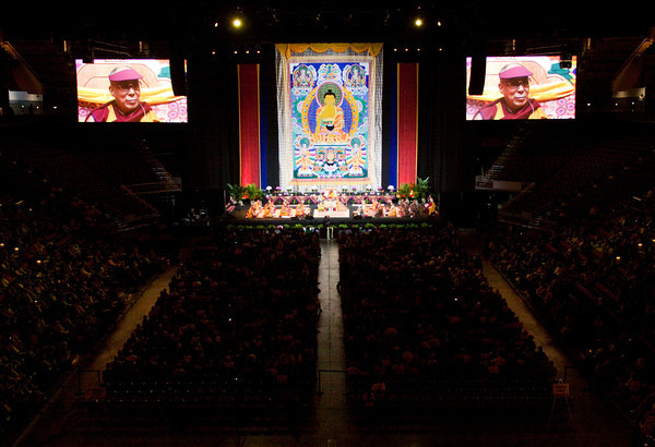 Audience members look on as the Dalai Lama speaks during a Buddhist teaching at the KFC Yum! Center in Louisville on Monday morning. Staff photo by Christopher Fryer
