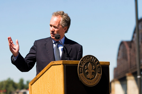 Louisville Mayor Greg Fischer speaks during a press conference announcing the introduction of 21 new commuter coaches to the Transit Authority of River City fleet next to the Big Four Bridge in Louisville on Monday afternoon. Ten of the new commuter coaches will be put into service today, and the other 11 will join the fleet by November. They run using clean diesel engines and are equipped with on-board Wi-Fi and power outlets for personal electronic devices. Staff photo by Christopher Fryer