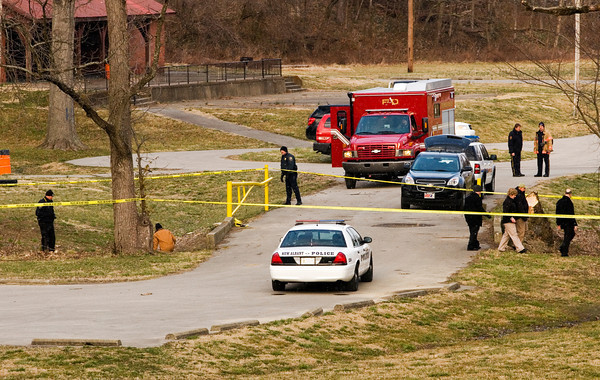 Emergency officials work the scene of a homicide investigation along Falling Run Creek in Binford Park in New Albany on Wednesday evening. An adult female and two children were found dead in the creek at about 5:15 p.m. Staff photo by Christopher Fryer