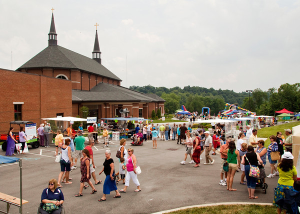 Festival goers move between booths during the third annual KnobsFest summer festival at St. Mary of the Knobs in Floyds Knobs on Saturday afternoon. Staff photo by Christopher Fryer