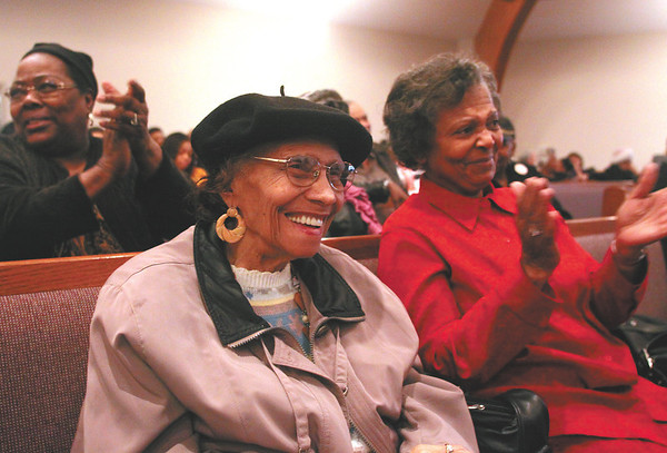 Sadie Lawler, center, and Brenda Matthews enjoy a comment by speaker Lindon Dodd while attending the Martin Luther King Jr. Day memorial service at Northside Church of Christ in Jeffersonville.  Staff photo by C.E. Branham
