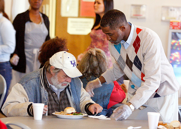 Victor Vinson, pastor of Gilt Edge Baptist Church in Jeffersonville, serves a meal to patron at the church's annual Thanksgiving dinner. Dinner was also served at Claysburg Towers. Staff photo by Jerod Clapp