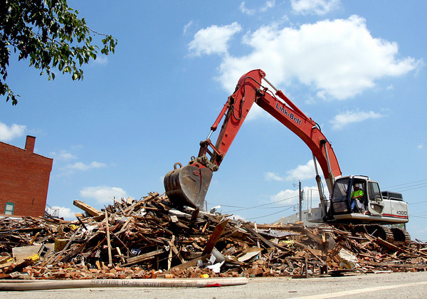 The City of Jeffersonville began clearing the debris of the former Tubby's Pizza building Monday. Staff photo by C.E. Branham