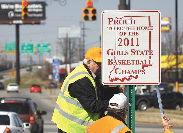The City of Jeffersonville installed a sign Tuesday at Exit 0 honoring the Jeffersonville High School girls basketball team 2011 state championship.  Staff photo by C.E. Branham