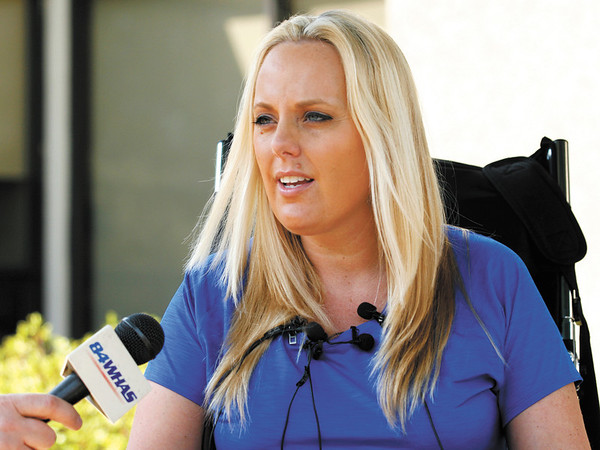 Stephanie Decker answers questions from the media after her release from Southern Indiana Rehab Hospital in New Albany on Monday afternoon. Both of Decker's legs had to be partially amputated after she was injured by debris while protecting her children in the basement of their home when the March 2 tornadoes hit the Henryville area. Staff photo by Christopher Fryer