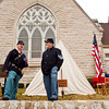 Reenactors Terry Furgason, North Vernon, right, and Bill Keller, New Albany, talk after setting up their encampment in front of St. Paul's Episcopal Church during a commemoration of the 150th anniversary of Abraham Lincoln's Gettysburg Address in Jeffersonville on Saturday afternoon. Staff photo by Christopher Fryer