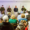 Officers with the Indiana Department of Natural Resources and the Clark County Sheriff's Office take questions and address issues during a gun safety seminar at the Clark County Casting and Conservation Club on Saturday afternoon. Staff photo by Christopher Fryer