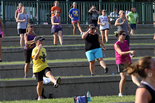 "More than 100 participants gathered at the Jeffersonville RiverStage Tuesday evening for a free Zumba class. The class is part of the ""Anchors A-Weigh"" program that offers free exercise classes to residents five days a week all summer. Staff photo by C.E. Branham"