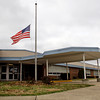 An American flag flies at half-mast in front of Bridgepoint Elementary School in Jeffersonville on Thursday afternoon. Staff photo by Christopher Fryer